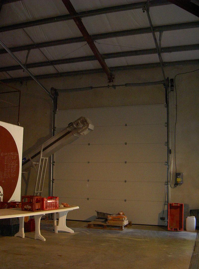 porte sectionnelle industrielle motoris e marconnet. Black Bedroom Furniture Sets. Home Design Ideas