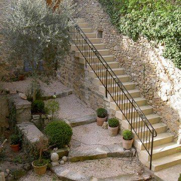Rampe escalier volutes ferronnier